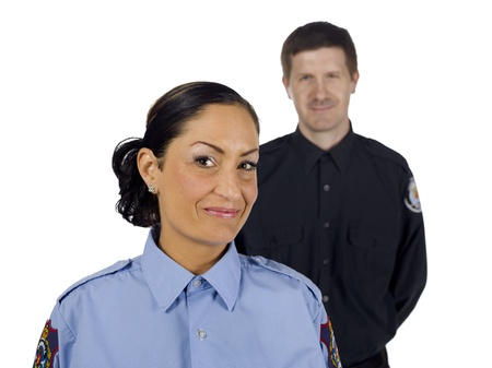 Portrait of happy police officers against white background