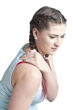 causaba: Mujer adulta mediados de tocar su hombro doloroso causado por la fatiga Foto de archivo