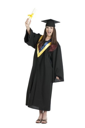Portrait of a proud female graduate raising her diploma