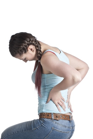 back ache: Image of woman suffering back pain against white background