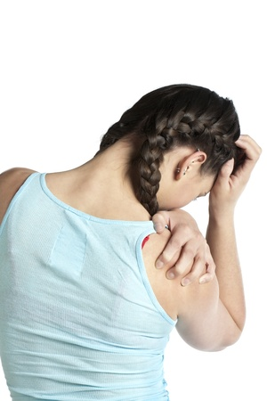Rear view of a woman suffering from a head ache against the white background photo