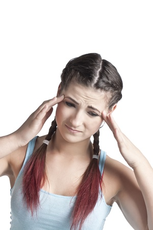vexation: Lovely woman touching her aching head