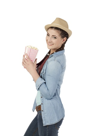 Pretty woman holding a box of popcorn over a white background photo