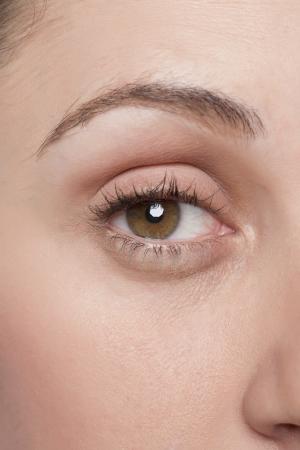 女性の茶色の目の画像を閉じる 写真素材