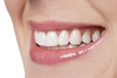 Closed up smiling woman with perfect white teeth photo