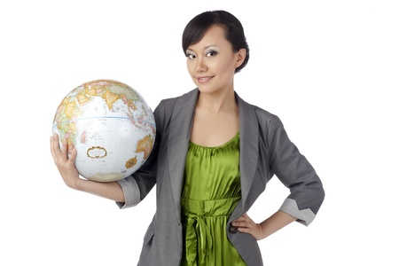 Portrait of attractive asian girl holding globe against white background Stock Photo - 17377029