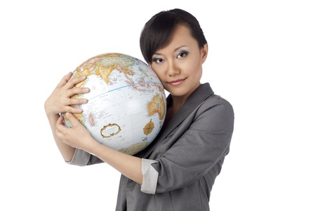 Close-up image of a lady holding the globe isolated on a white surface Stock Photo - 17377052