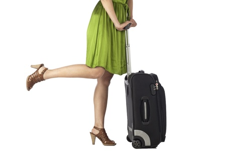 Cropped image of female traveler against white background photo