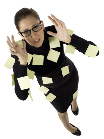 overworking: High angle shot of a frustrated secretary covered with sticky notes Stock Photo
