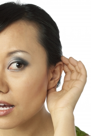Close up image of listening woman against white backgound