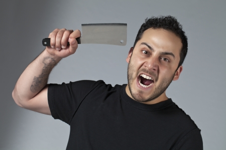 Image of a creepy mad man holding a sharp knife photo