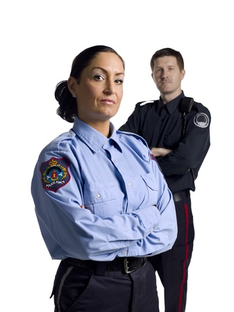 Portrait of male and female police officers with arm crossed on a white background Standard-Bild