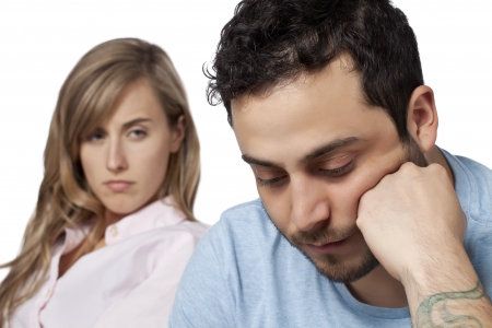 lovers quarrel: Portrait of a woman looking on sad man, having relationship problems