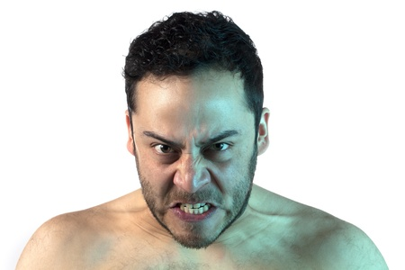 Close up image of man gesturing an angry face against white background Stock Photo - 17377054