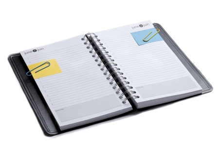 notebook: Horizontal image of an open organizer note book with paper clips and post it