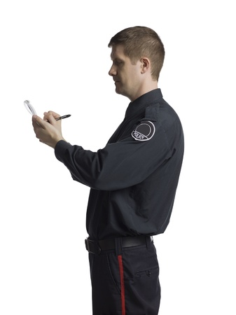 Policeman noting something on his notepad Stock Photo - 17377366