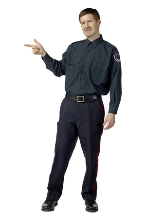 Portrait of policeman pointing at something against white background Stock Photo - 17377376