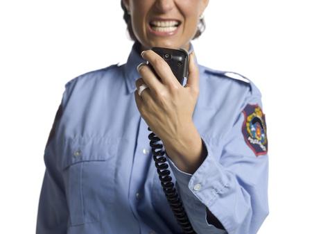 cb: Cropped image of a policewoman having radio conversation Stock Photo