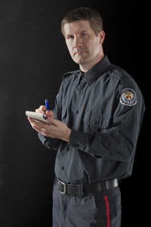Close up image of police officer against black background Stock Photo - 17377498