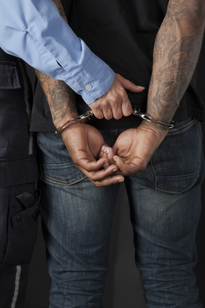 Close up image of police officer arrested a criminal Stock Photo - 17400542