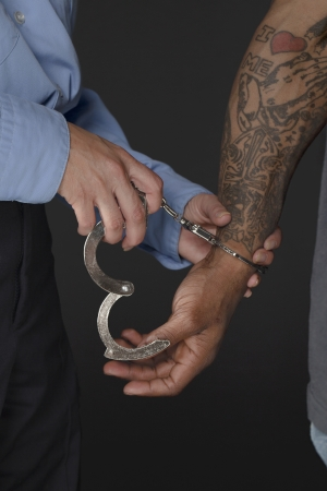 Close up image of police officer handcuffing a man Stock Photo - 17400498