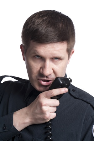 cb phone: Close-up image of a police officer talking on cb phone against the white background Stock Photo