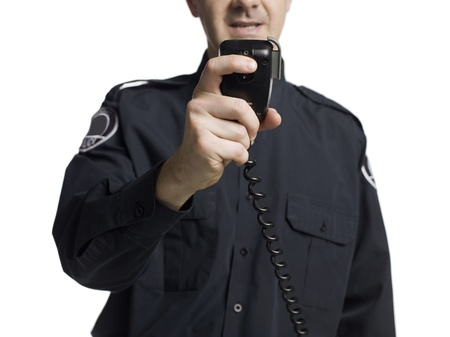 Police officer holding a cb radio