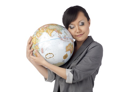Portrait of petty asian lady with globe against white background Stock Photo - 17400383
