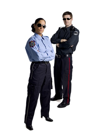 Full length portrait of professional police officers against white background Standard-Bild