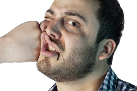 Close up image of punch straight to a man face against white background photo