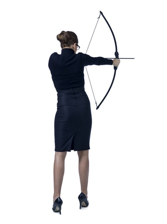 Rear view shot of a businesswoman aiming her bow over a white background photo