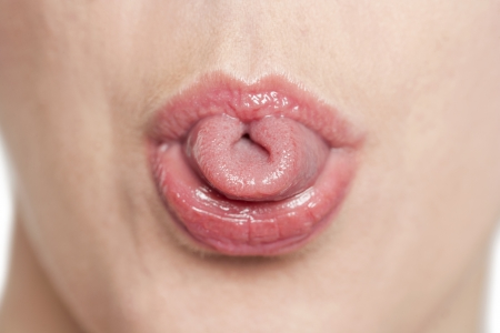 Closed up woman rolling her tongue