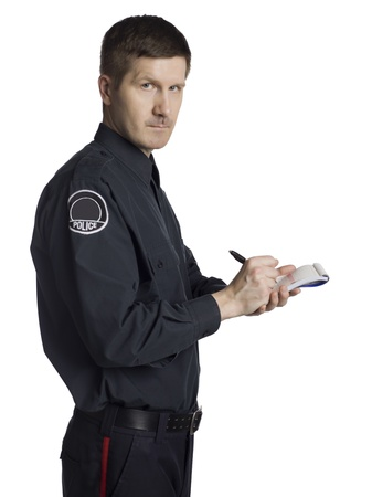 Side view of serious policeman writing notes on a white background photo