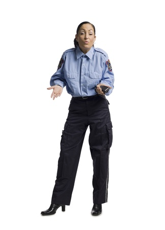 Full length image of a policewoman shrugging her shoulder photo