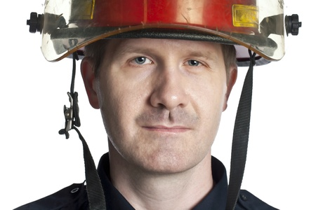 Closed up shot of smiling fireman over a white background photo