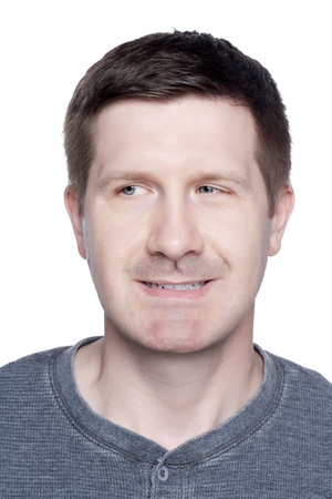 Portrait of smiling man looking at something against white background photo