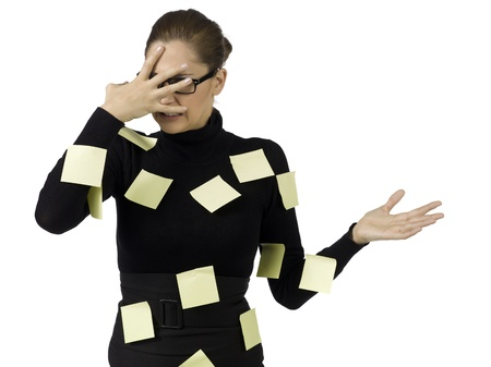 post: Portrait of stressed businesswoman filled up with post it notes Stock Photo