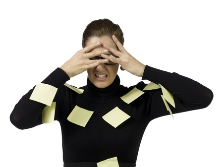 Image of tired businesswoman filled up with post it notes in her body photo