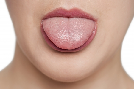 licking tongue: Unrecognizable female sticking her tongue out Stock Photo