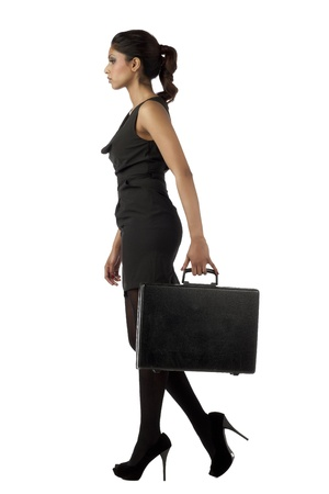 Full length image of a walking businesswoman carrying a briefcase photo