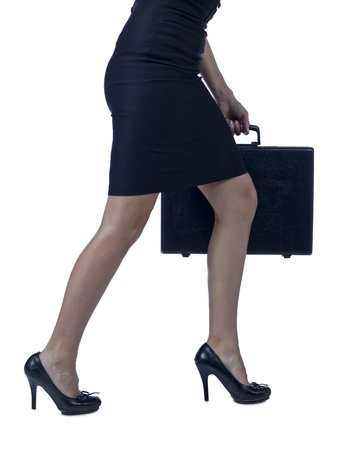 Waist-down shot of a walking businesswoman holding a briefcase photo
