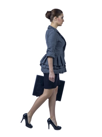 Sophisticated lady holding a briefcase while walking over a white background photo