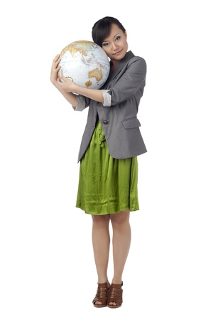 Portrait of woman holding a globe against white background photo