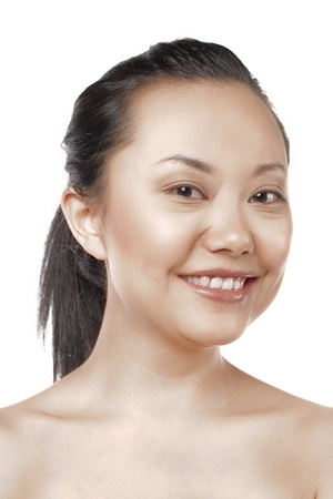 Close-up image of a woman smiling on a white background photo