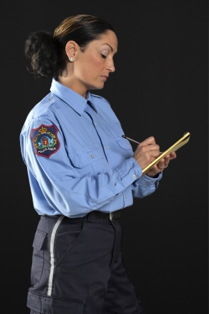 Writing police officer over a black background Stock Photo - 17373332