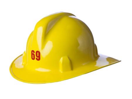 Close-up beeld van gele brandweerman helm tegen een witte achtergrond Stockfoto