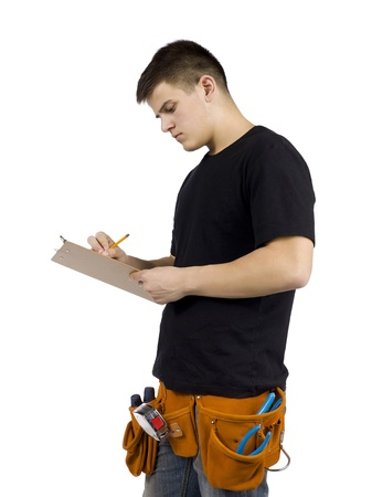 Portrait of young male carpenter writing something over white background Imagens