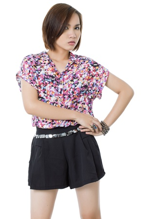 Asian woman posing with hand on hip photo