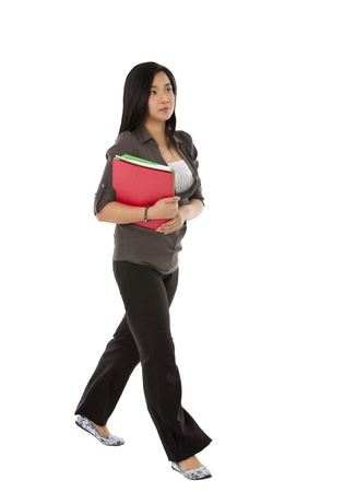 A woman holding files and walking in a vertical image Stock Photo - 17391663