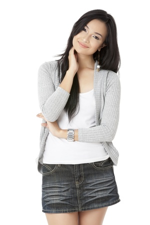 Portrait of smiling woman with hand on her neck Stock Photo
